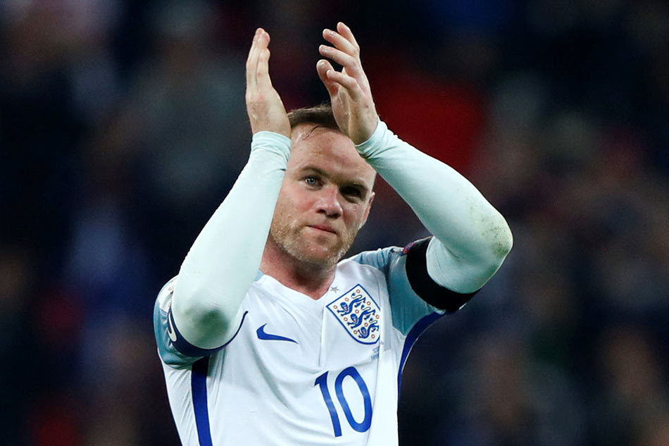 Wayne Rooney showered with praise after announcing England retirement