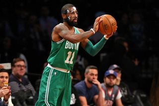 Masked-man Irving leads Celtics to 13th win in a row