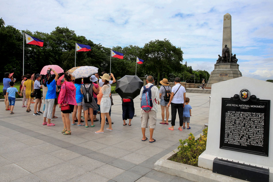 Tourists look at Jose Rizal