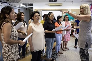 Migrant Pinay moms in Hong Kong sing for their distant children