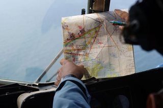 Malaysia says no evidence pilot caused MH370 disappearance