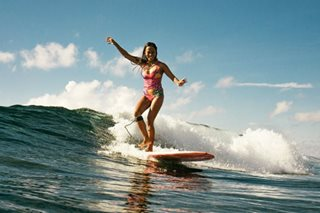 Surfer Elaine Abonal rides the tide against all odds
