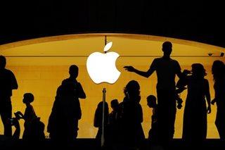 Apple hits historic $1-trillion stock market valuation