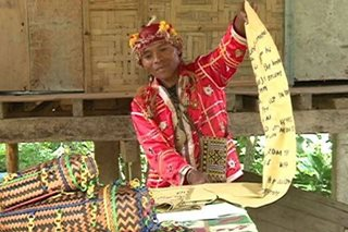 Lumad sells tribal bags to fund school supplies for his students