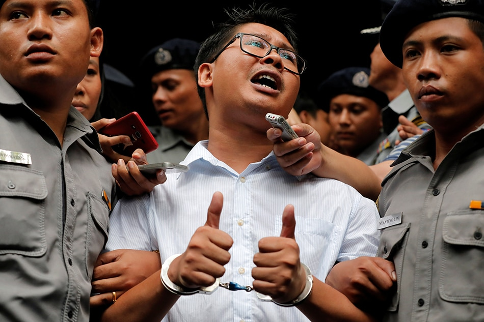 Court sentences Reuters reporters to seven years in jail