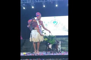 Contestant parades with child, goats in gay pageant