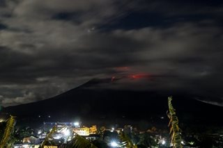Mayon peeks behind clouds