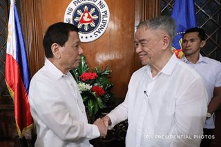 LOOK: President Duterte shakes hands with Lucio Tan