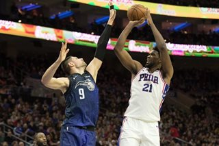 Embiid leads Sixers past Magic for 7th straight win