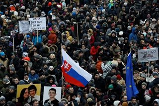 Thousands march for slain Slovak journalist who probed corruption