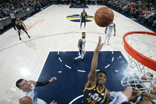 Jazz pull away late, cruise past Magic