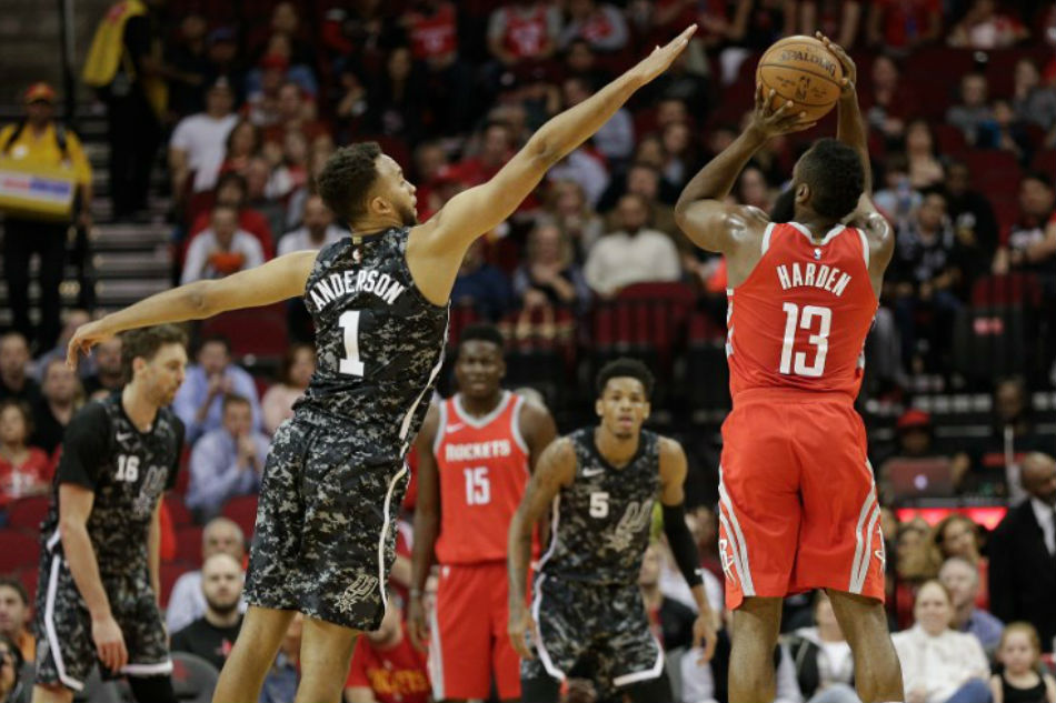 9ccedc3a8 James Harden (13) of the Houston Rockets shoots a three point basket over  Kyle Anderson (1) of the San Antonio Spurs at Toyota Center on March 12