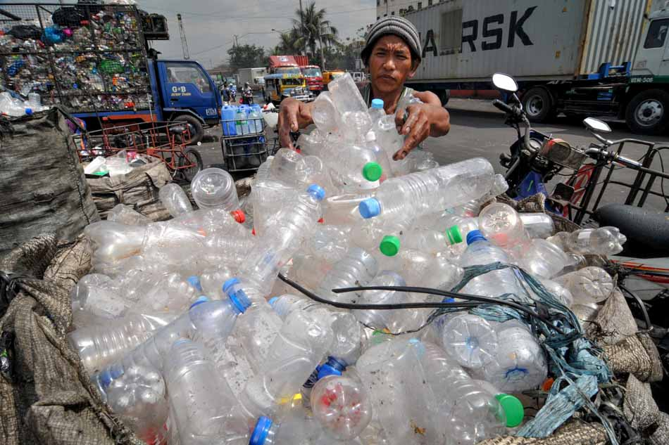 Workers sort plastic bottles for sale at a plastic recycling factory in R10 Tondo Manila. ABS-CBN News file