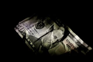 Dollar hits 16-month lows vs yen as trade, political woes take their toll