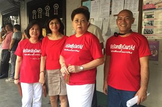 SC employees wear red in show of support for Court Admin Marquez