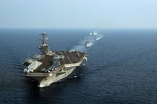 US displays military muscle as carrier sails in South China Sea