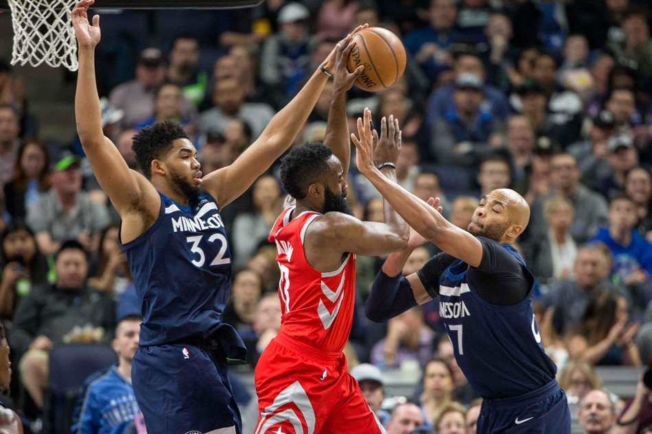 33d317ea24b Houston Rockets guard James Harden (13) attempts to pass the ball past  defense from Minnesota Timberwolves center Karl-Anthony Towns (32) and  forward Taj ...
