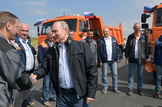 Putin opens new bridge to Crimea, provoking Ukraine, Western ire