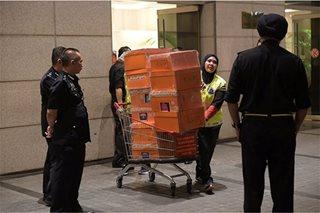 Malaysia's ex-PM Najib Razak rails at police, wife warns of 'public trial'