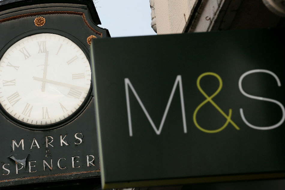 Marks & Spencer signs are seen outside outside a store in London Britain