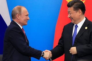 As G7 feuds, Xi and Putin play up their own club