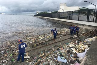 LOOK: Garbage galore in Manila Bay after days of Habagat