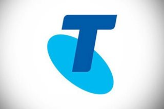 Australia telecom giant Telstra flags tough times as profit slides