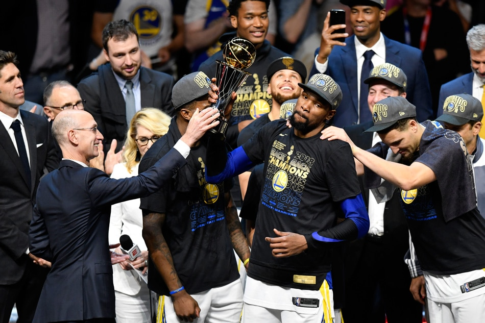 ac1147e10c6d Golden State Warriors forward Kevin Durant (middle) receives the Bill  Russell NBA Finals Most Valuable Player Award from NBA Commissioner Adam  Silver (left) ...