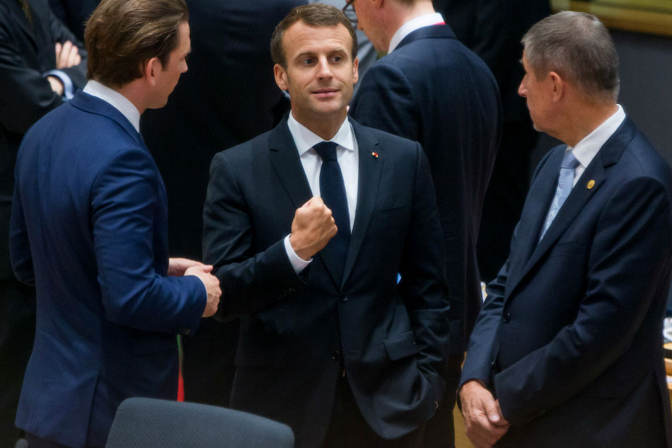 Macron welcomes European Union migration deal, but acknowledges pressures will continue