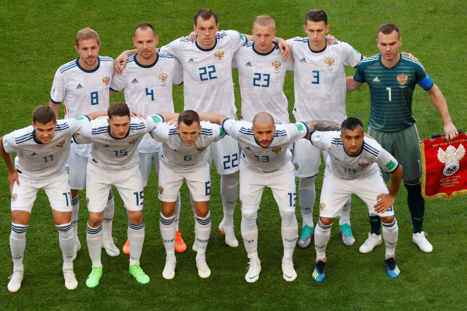 Russia players pose for a team group