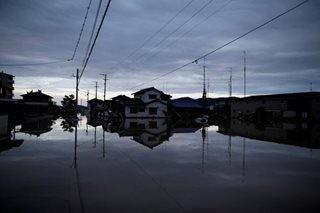 Official death toll from record Japan rains rises to 75