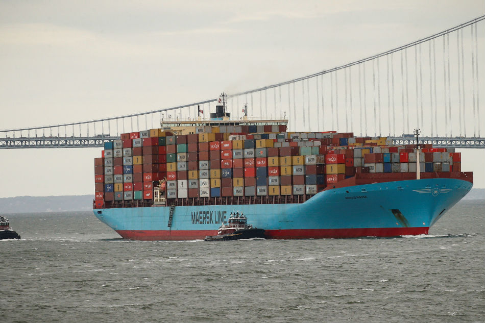 A Maersk container ship is guided by a tug boat in New York Harbor in New York City US. Brendan McDermid Reuters