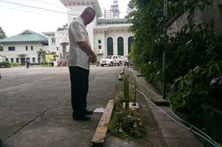 LOOK: Cebu archbishop prays for slain armed 'visitor'