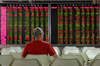 Asian shares edge lower as investors await China data