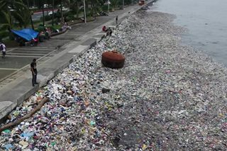 WATCH: Garbage accumulates in Manila Bay after heavy rains