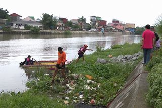Low-lying areas near Tullahan River warned of possible flooding if La Mesa Dam overflows