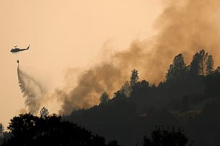 Monster wildfire in California rages on after killing 2 firefighters