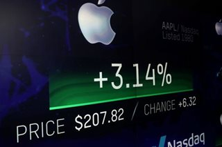 Trade fight weighs on world stocks; Apple milestone boosts US