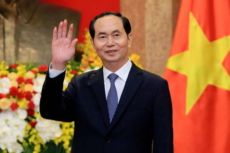 Vietnamese President Tran Dai Quang greets journalists at the Presidential Palace in Hanoi Vietnam