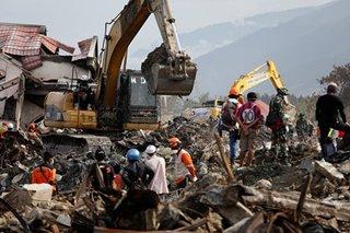 Indonesia calls off grim search for dead in quake-tsunami disaster