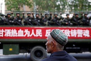 China says Xinjiang has 'boarding schools', not 'concentration camps'