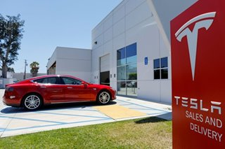 Tesla reports 'historic' profitable quarter