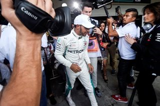 Hamilton joins Fangio with 'surreal' fifth world title