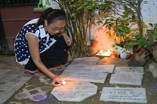 In loving memory: Woman lights candles for deceased pets on Undas