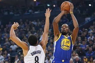 Cook leads short-handed Warriors over Nets