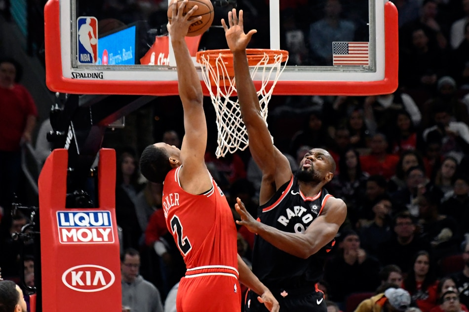 Toronto Raptors forward Serge Ibaka (9) defends Chicago Bulls forward  Jabari Parker (2) at United Center. David Banks, USA TODAY SportsReuters
