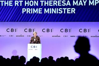 UK's May wins business support for draft Brexit deal