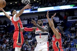 Holiday, Pelicans shoot past Wizards