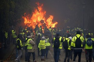 France halts fuel tax hikes in bid to calm fiery protests