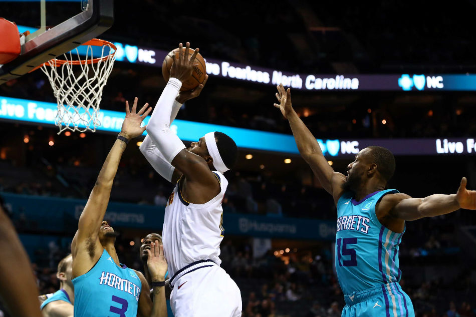 Walker scores 21, Hornets snap Nuggets' 7-game win streak | AP sports